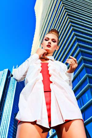 Fashion model posing over big city background. Stock Photo - 15389058