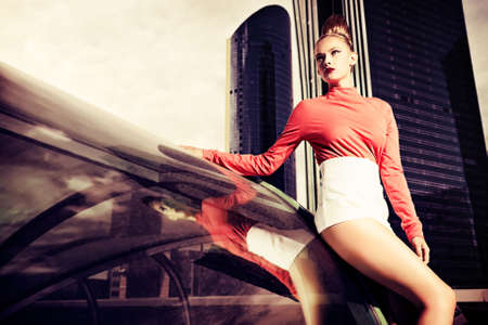 Vogue model posing over big city background. Stock Photo - 15389023