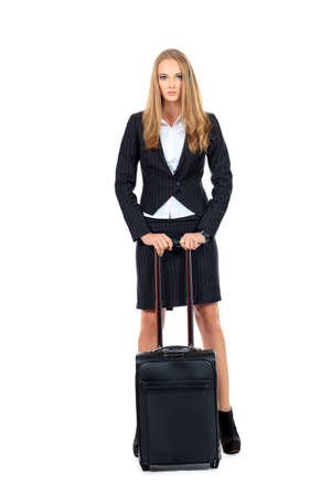 Full length portrait of a successful young business woman standing with travel bag. Isolated over white. photo