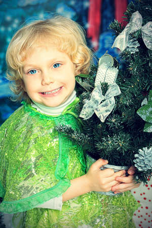 Happy little girl posing in Christmas dress  Stock Photo - 15400523