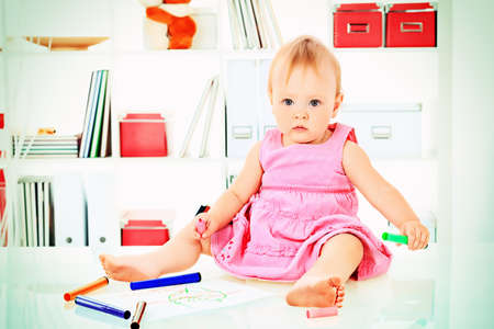 baby drawing: Cute baby girl playing at home. Stock Photo