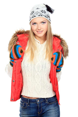 Portrait of a smiling blonde girl in warm clothes. Isolated over white. photo