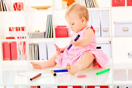 Cute baby girl playing at home. photo