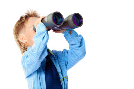 Curious little boy is looking through binoculars. Isolated over white background. Stock Photo - 15473580