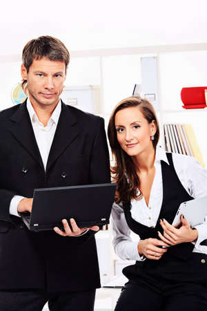 Business woman and businessman working together at the office. Stock Photo - 15473586