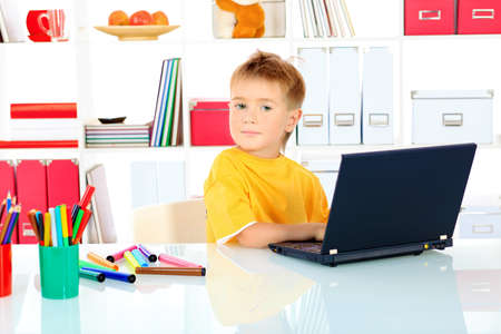 Little boy with his laptop at home. Stock Photo - 15446094