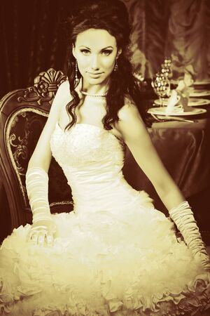 Beautiful bride in a luxurious restaurant. Vintage style. photo