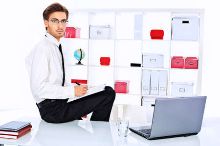 Handsome businessman is working on a laptop at the office. Stock Photo - 15544394