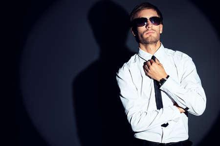 formal shirt: Portrait of a handsome man over black background.