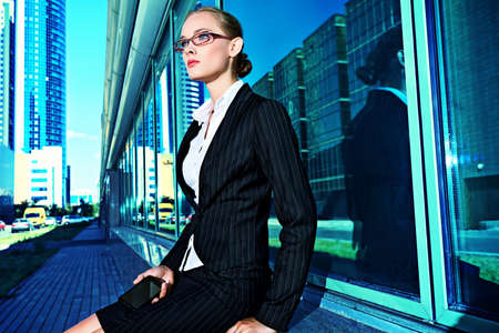 big woman: Young business woman in the big city purposefully looking away.