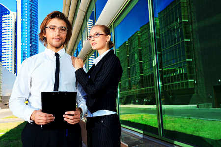 Business people standing in a big city over modern buildings. Stock Photo - 15584706