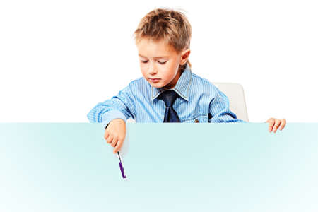 Portrait of a little boy in shirt and tie holding white board. Isolated over white background. photo