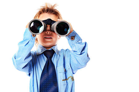 Curious little boy is looking through binoculars. Isolated over white background. Stock Photo - 15584713