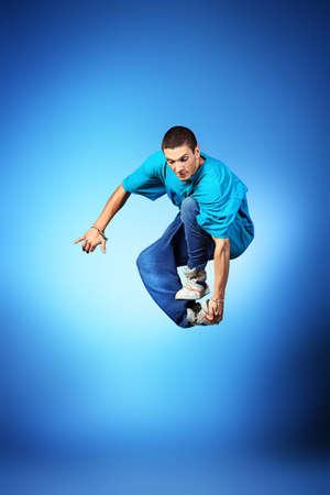 Young man dancing hip-hop at studio. Stock Photo - 15608461