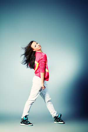 Modern girl dancing hip-hop at studio. Stock Photo - 15608390