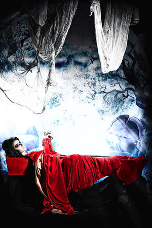 bloodthirsty: Bloodthirsty vampire woman lies in a coffin in the night cemetery.