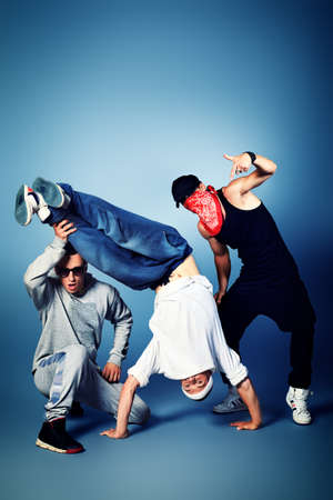 cool boys: Group of modern dancers dancing hip-hop at studio. Stock Photo