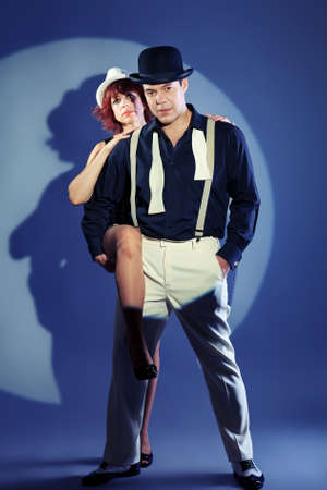 Couple of professional singers in retro style posing in costumes at studio. Stock Photo - 15684230