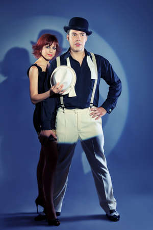 Couple of professional singers in retro style posing in costumes at studio. photo