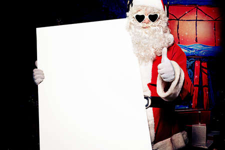 christmas music: Party Santa Claus holding white board over Christmas background.