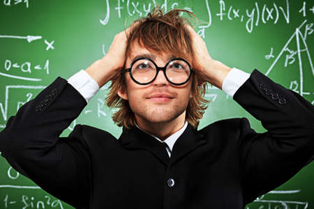 Portrait of a stressed male student near the blackboard.  Stock Photo - 15771177