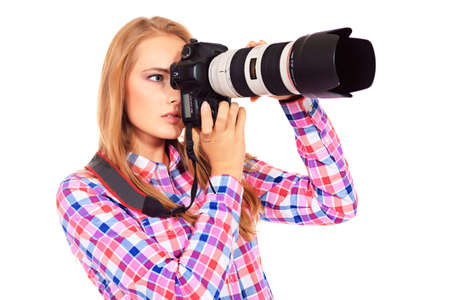 snapshot: Pretty young woman taking pictures on the camera. Isolated over white.