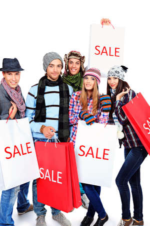 Group of cheerful young people with shopping bags. Isolated over white background. Stock Photo - 15771181
