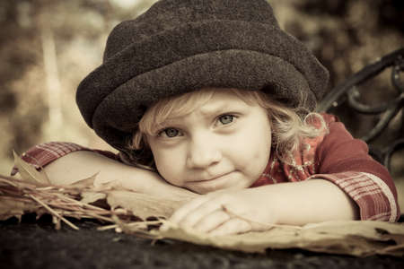Cute little girl having a rest at a park. Retro style. Stock Photo - 15771221
