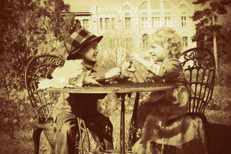 vintage children: Cute children having a rest at a park. Retro style.