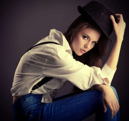 Shot of an attractive fashionable girl posing in studio. photo