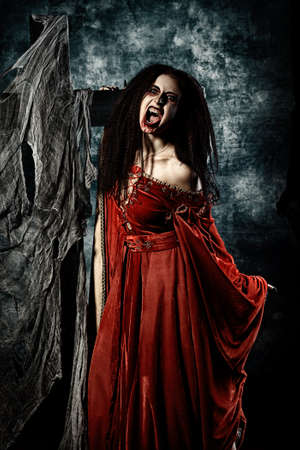 satanic: Portrait of a bloodthirsty female vampire. Stock Photo