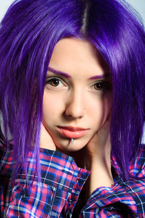 Portrait of a punk girl with purple hair.  photo