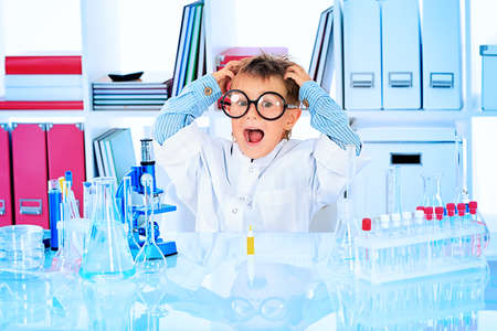 Cute boy is making science experiments in a laboratory. Education. Stock Photo - 15882809