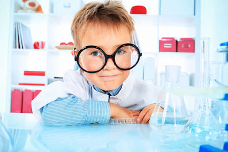 Cute boy is making science experiments in a laboratory. Education. Stock Photo - 15883066