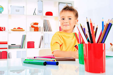 Little boy drawing in his notebook at home. Stock Photo - 15883029