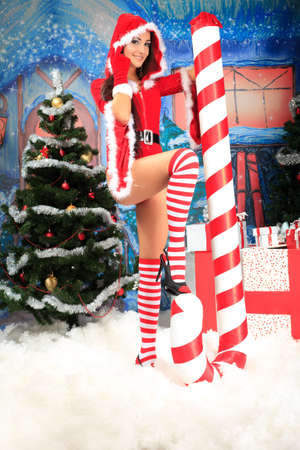 Beautiful young woman in Santa Claus clothes over Christmas background. Stock Photo - 15886956