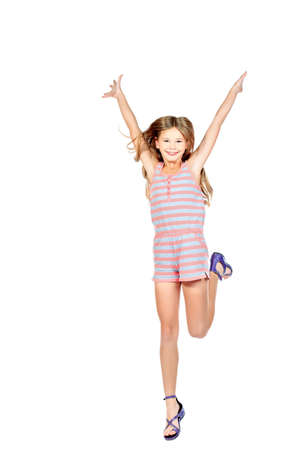 Cute girl jumping for joy. Isolated over white. photo
