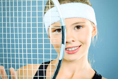 tennis racket: Portrait of a girl tennis player holding tennis racket. Studio shot.  Stock Photo