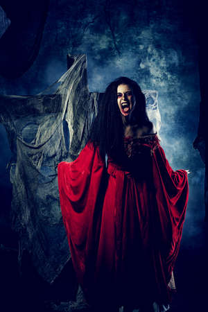 bloodthirsty: Portrait of a bloodthirsty female vampire. Stock Photo