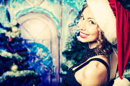 An attractive young woman is celebrating Christmas. photo
