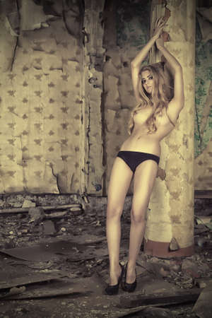 Attractive nude woman in the old house