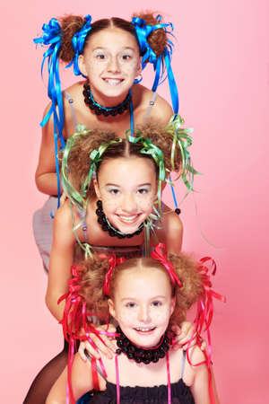Portrait of three beautiful girls with festive make-up, hairstyle and dress   photo