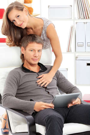 Happy married couple having good time together at home. Stock Photo - 15963483