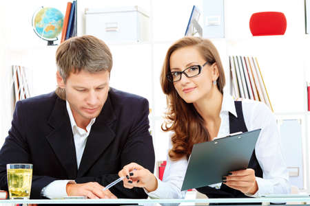 Business woman and businessman working together at the office. Stock Photo - 15963539