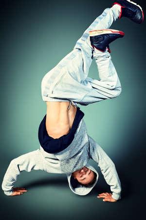 Trendy young man dancing hip-hop at studio.