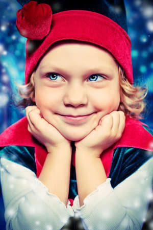 Portrait of a funny little girl in Christmas elf costume. photo