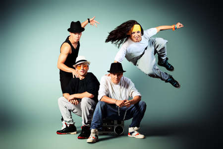 boombox: Group of modern dancers dancing hip-hop at studio. Stock Photo