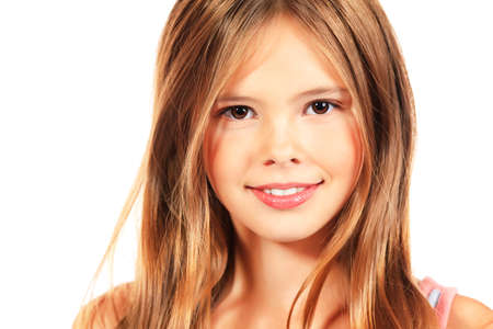 teen girl smile face: Portrait of a happy girl smiling at camera. Isolated over white. Stock Photo