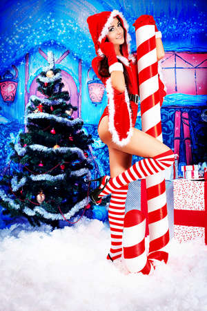 Beautiful young woman in Santa Claus clothes over Christmas background. Stock Photo - 16050643