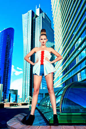 Full length portrait of a fashion model posing over big city background. Stock Photo - 16050611